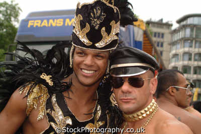 black transvestite gay white man hugging homosexuals queers poofs men adult males masculine manlike manly manful virile mannish people persons westminster london cockney england english angleterre inghilterra inglaterra united kingdom british
