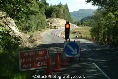 highland roadworks sign saying red light shows wait motor cars automobiles transport transportation uk road works traffic lights dunoon argyll bute argyllshire scotland scottish scotch scots escocia schottland great britain united kingdom british
