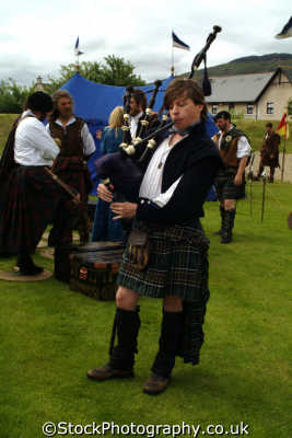 piper playing bagpipes traditional clan dress highland games costumes costumed people persons fort william highlands islands scotland scottish scotch scots escocia schottland great britain united kingdom british