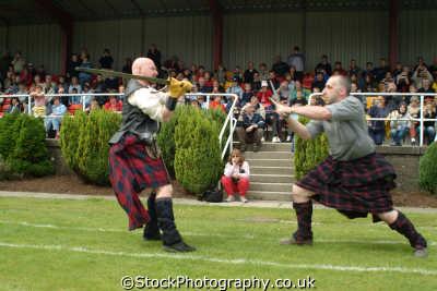 scots clans swordfight display highland games costumes costumed people persons agression war armed combat affray battle fort william highlands islands scotland scottish scotch escocia schottland great britain united kingdom british