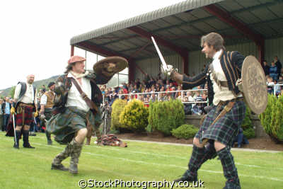 scots clans swordfight display highland games costumes costumed people persons agression war armed combat affray battle fort william highlands islands scotland scottish scotch escocia schottland great britain united kingdom british