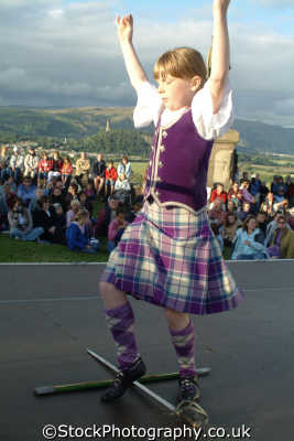 girl highland dancing swords human activities people persons tartan stirling stirlingshire scotland scottish scotch scots escocia schottland great britain united kingdom british