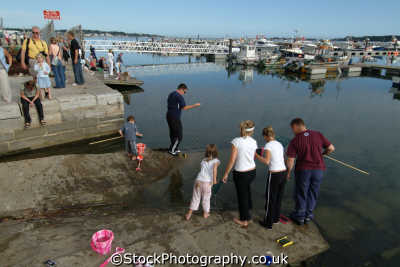 poole harbour fishing crabs quay harbor uk coastline coastal environmental dorset england english great britain united kingdom british