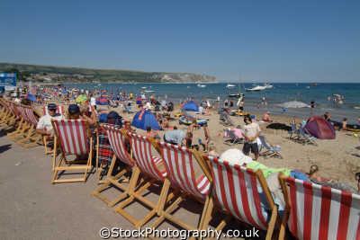 swanage deck chairs promenade british beaches coastal coastline shoreline uk environmental purbeck dorset england english great britain united kingdom