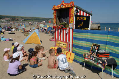 punch judy british beaches coastal coastline shoreline uk environmental domestic violence swanage purbeck dorset england english great britain united kingdom
