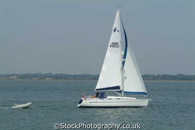 yacht sail towing tender yachts yachting sailing sailboats boats marine misc. isle wight england english great britain united kingdom british
