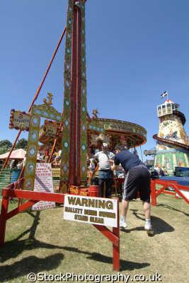 olde time striker fairground royal cornwall show. men swinging mallett ring bell carnival fairs leisure uk macho man cornish england english great britain united kingdom british