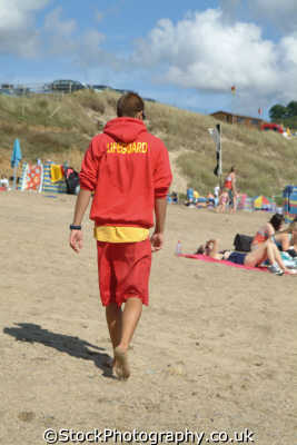 lifeguard patrolling praa sands beach cornwall rnli coastguard lifeboat rescue uk emergency services cornish england english great britain united kingdom british