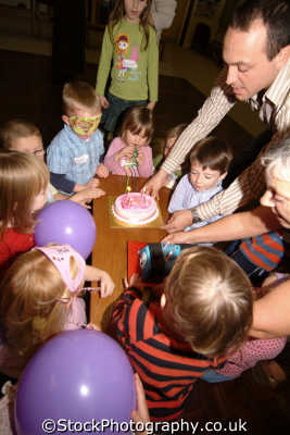 birthday cake childrens party children infant groups people persons united kingdom british