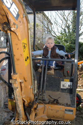 toddler driving mini digger children working people persons excavation health safety united kingdom british