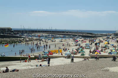 lyme regis dorset west beach harbour high summer seafront uk coastline coastal environmental crowded england english great britain united kingdom british