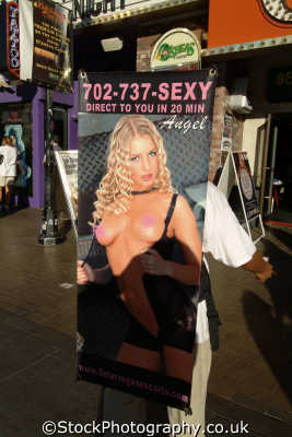sandwich board advertising prostitutes las vegas female sexuality sexually attractive attraction women woman females feminine womanlike womanly womanish effeminate ladylike people persons sex prostitution hookers gambling gamblers nevada usa united states america