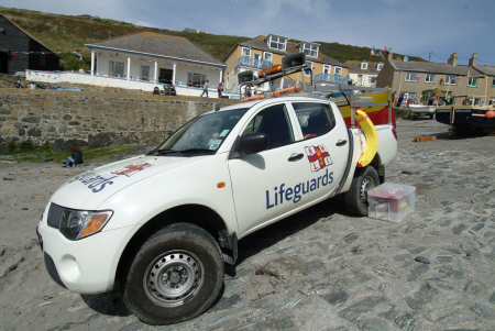 lifeguards vehicle. mullion harbour day rnli coastguard lifeboat rescue uk emergency services lizard cornwall cornish england english angleterre inghilterra inglaterra united kingdom british