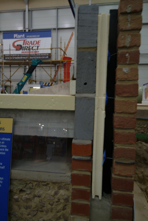 cutaway brick block wall showing beam foundations construction building industry industrial uk business commerce united kingdom british