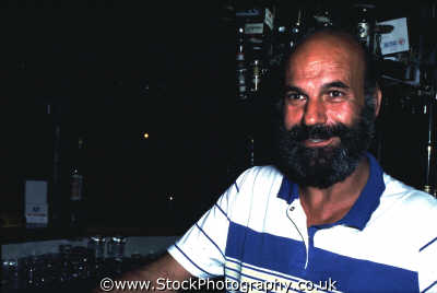 bald man beard bar men adult males masculine manlike manly manful virile mannish people persons pub barman alchohol cyprus europe european cypriot