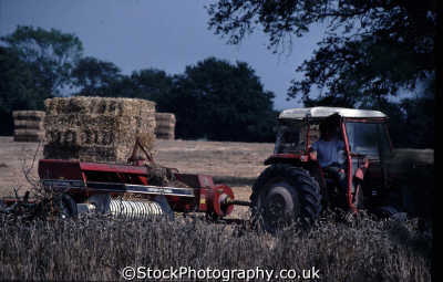 tractor baling hay field rural britain countryside rustic pastoral environmental uk sheaves sussex home counties england english angleterre inghilterra inglaterra united kingdom british