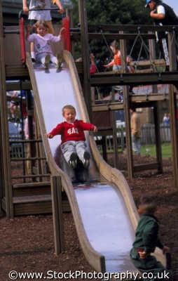 children playing playground slide infant groups people persons play england english angleterre inghilterra inglaterra united kingdom british