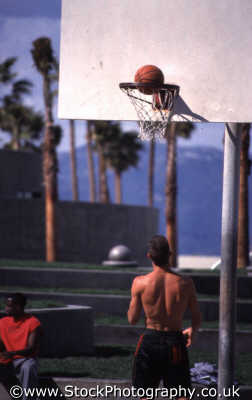 basketball player stripped waist looking ball hoop muscle beach sports sporting uk venice santa monica la los angeles california californian usa united states america american