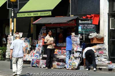 man glancing black woman news stand w1 shops shopping buildings architecture london capital england english uk interaction race newspaper westminster cockney angleterre inghilterra inglaterra united kingdom british