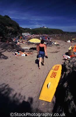 surf rescue longboard person british beaches coastal coastline shoreline uk environmental surfboard safety lifeguard devon devonian england english angleterre inghilterra inglaterra united kingdom