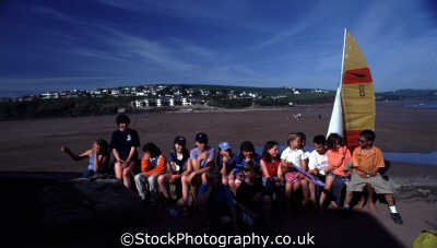 kids sitting wall children infant groups people persons outing chatter devon devonian england english angleterre inghilterra inglaterra united kingdom british