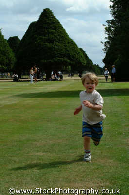 boy running grass matthew boys male child males masculine manlike manly manful virile mannish people persons race run middlesex middx england english angleterre inghilterra inglaterra united kingdom british