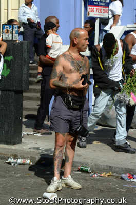 tattooed man notting hill carnival men adult males masculine manlike manly manful virile mannish people persons tough tattoos hard bald black culture street colour color parade celebrate party kensington chelsea london cockney england english angleterre inghilterra inglaterra united kingdom british