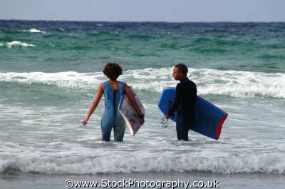 boy girl bodyboarders surfing surfboarding extreme sports adrenaline sporting uk love cool newquay cornish cornwall england english angleterre inghilterra inglaterra united kingdom british
