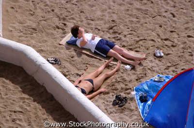 bikini sunbathing british beaches coastal coastline shoreline uk environmental holiday vacation sunny sunshine newquay cornish cornwall england english angleterre inghilterra inglaterra united kingdom