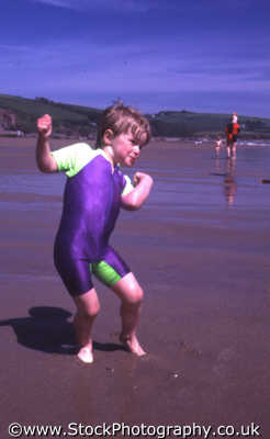 leaning matthew boys male child males masculine manlike manly manful virile mannish people persons boy beach seaside devon devonian england english angleterre inghilterra inglaterra united kingdom british