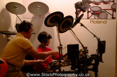 boy dad playing drums music musicians musical arts misc. drummer rock drumstick cymbals snare west united kingdom british