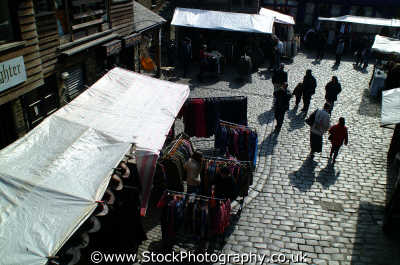 camden market stalls cobblestones markets famous sights london capital england english uk stall bric brac shadows people crowds throng cockney angleterre inghilterra inglaterra united kingdom british