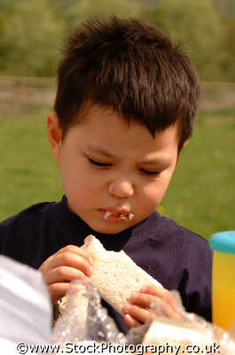 boy eating sandwich boys male child males masculine manlike manly manful virile mannish people persons england english angleterre inghilterra inglaterra united kingdom british