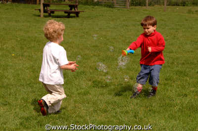 boys playing bubbles male child males masculine manlike manly manful virile mannish people persons fun games learning england english angleterre inghilterra inglaterra united kingdom british