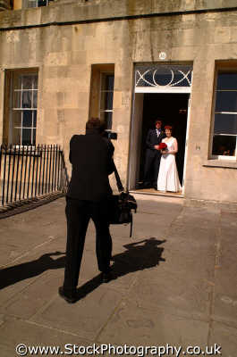 wedding photographer bride groom doorway professions professionals career working people persons camera photography photographic wiltshire wilts england english angleterre inghilterra inglaterra united kingdom british