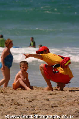 lifeguard pointing little boy uk emergency services lifesaving help newquay cornish cornwall england english angleterre inghilterra inglaterra united kingdom british