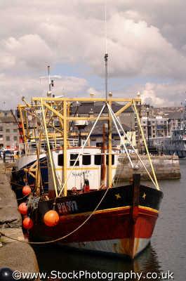 fishing boats harbour wall harbor uk coastline coastal environmental plymouth devon devonian england english angleterre inghilterra inglaterra united kingdom british