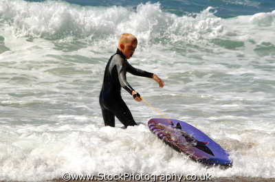 junior board surfer surfing surfboarding extreme sports adrenaline sporting uk surfers cornwall cornish england english angleterre inghilterra inglaterra united kingdom british