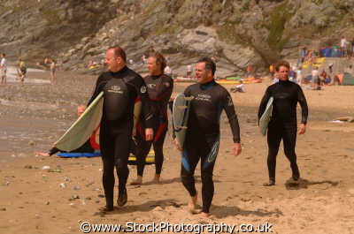 middle aged surfers beach surfing surfboarding extreme sports adrenaline sporting uk cornwall cornish england english angleterre inghilterra inglaterra united kingdom british