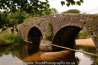 bridge troubled waters dartmoor uk bridges rivers waterways countryside rural environmental arches devon devonian england english angleterre inghilterra inglaterra united kingdom british
