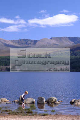 child paddling loch morlich cairngorm mountains countryside rural environmental uk moray morayshire scotland scottish scotch scots escocia schottland united kingdom british