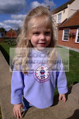 little girl blonde hair standing wall girls female children kids ...
