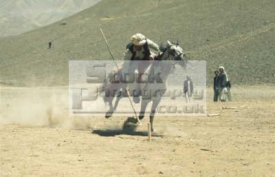 afghan man tent pegging gallop horseback uprooting pegs afghanistan bamiyan indiginous people asian travel horse peg asia afganistan afganistani