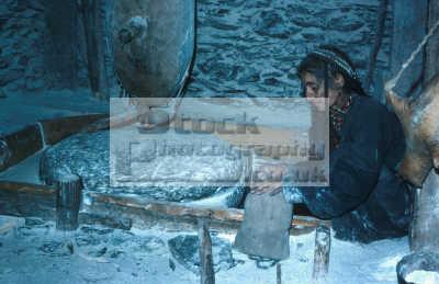 kalash woman grinding maize water birrir kafiristan nw pakistan corn pakistani asian travel milling asia