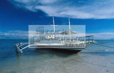 boat outriggers known locally 'banca'. alona beach bohol philippines yachts yachting sailing sailboats boats marine misc. pacific oceanic sea oceans philippino
