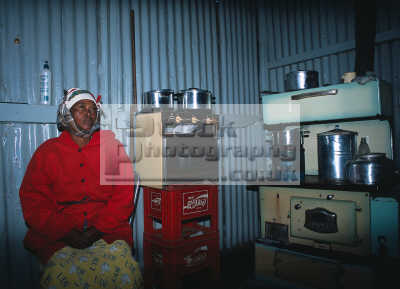 black woman township house kitchen soweto southern african travel poverty poor johannesburg joburg south africa afrikaans