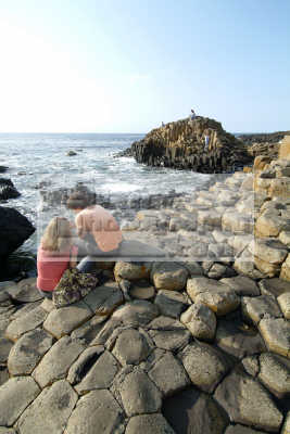 young couple giant causeway ireland lovers romance romantic couples husband wife boyfriend girlfriend spouse families family kin kinfolk tribe generations geneaology people persons giants county antrim aontroim northern ulster irish irland irlanda united kingdom british