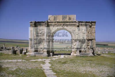 triumphal arch main gate volubilis morocco. street decumanus maximus roman century ad. called tangier gate. moroccan african travel ancient rome history historical morocco maroc africa