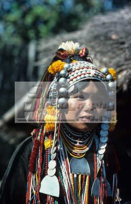 girl akha hill tribe colourful elaborate headdress. doi tung village northern thailand. indiginous people african travel thailand asia thai