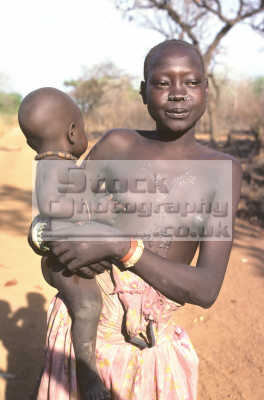 Azende girl with baby southern sudan elaborate scarring for African body decoration